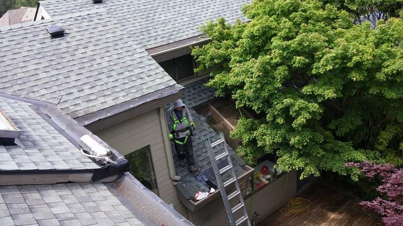 cleaning roof | Army Roofing Inc.