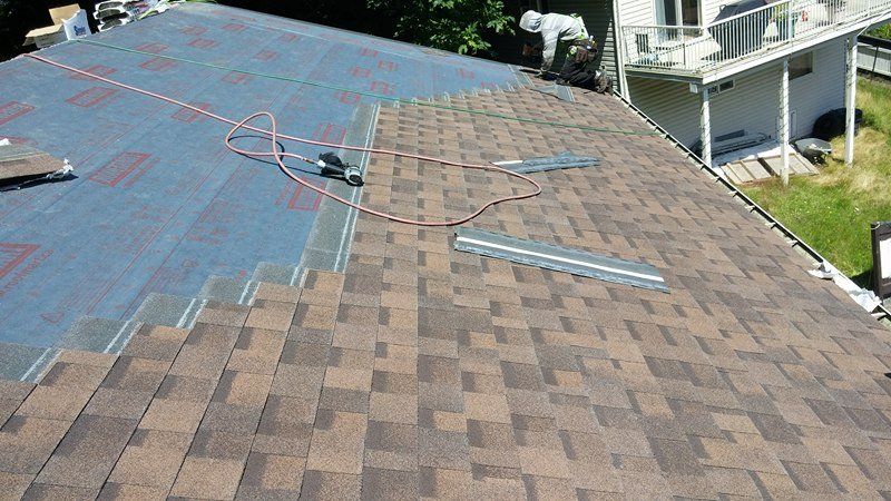 putting roof layers | Army Roofing Inc.