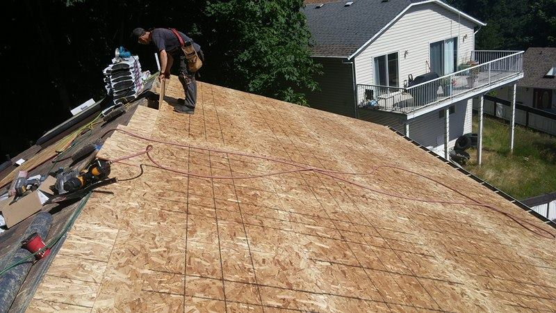 laying out wood on the roof | Army Roofing Inc.