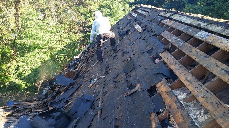 cleaning out old roof | Army Roofing Inc.