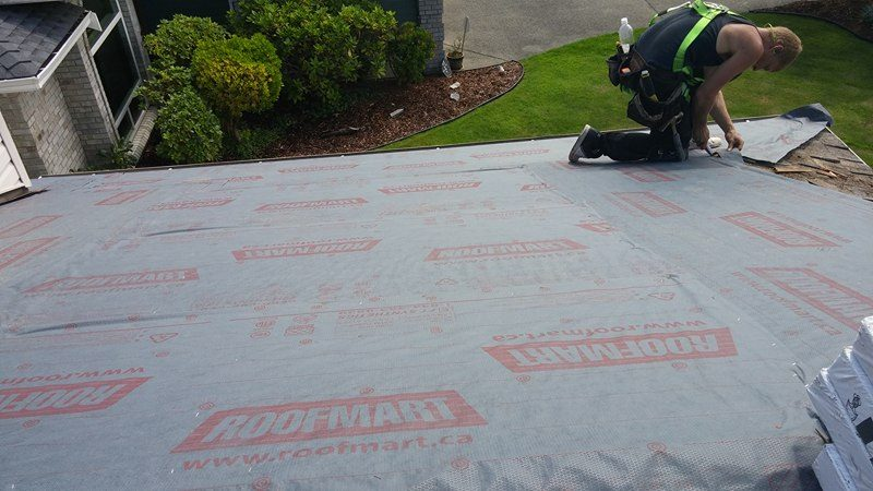 installing new roof in Delta | Army Roofing Inc.