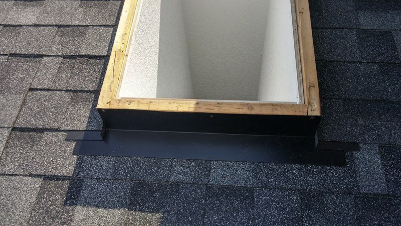 roof with open skylight | Army Roofing Inc.