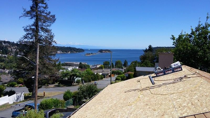 working on the roof view | Army Roofing Inc.