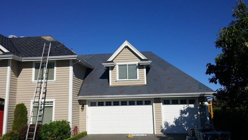 cover under the roofing project in Delta | Army Roofing Inc.