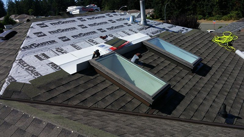 two skylights with new roof in Delta | Army Roofing Inc.