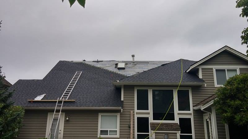 finishing up reroofing project in Delta | Army Roofing Inc.