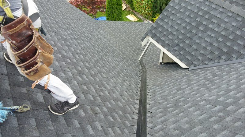 working on a roof in Delta | Army Roofing Inc.